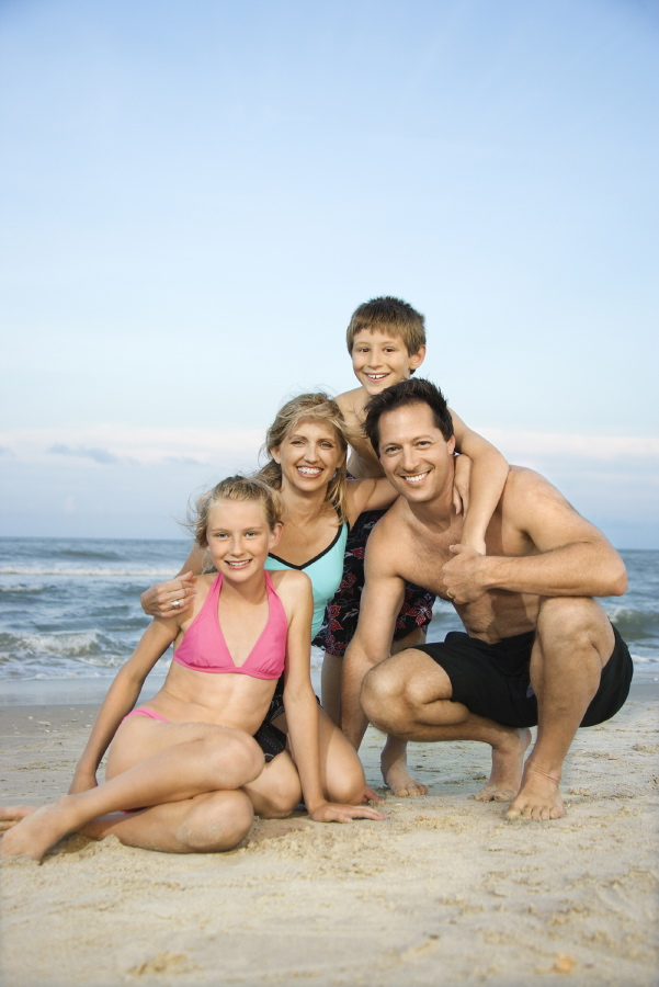 Smiling Happy Family On Beach